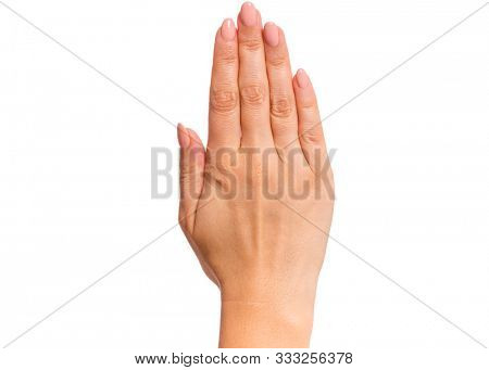 Female hand showing stop sign, isolated on white background. Beautiful hand of woman with copy space.