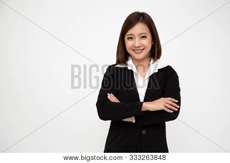 Portrait Of Successful Business Asian Women In Black Suit With Arms Crossed And Smile Isolated Over