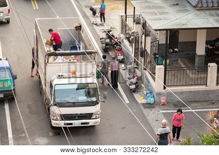 Nantou, Taiwan - November 6th, 2019: white recycling truck for collects recyclable materials in a small lanes at Puli township, Nantou, Taiwan, Asia
