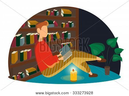 Young Man Sitting On The Floor In Library And Reading Book. Leisure Activity, Repose And Relaxation.
