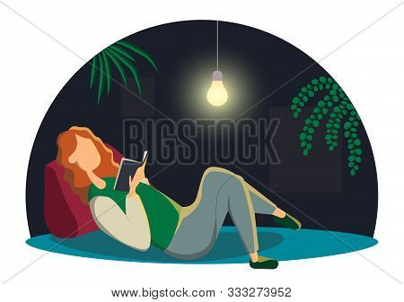 Beautiful Redhead Woman Lying Down Reading A Book. Adorable Young Woman Spending Weekend At Home. Le