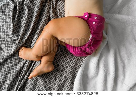 Sleeping Baby With Cloth Diaper. Top View. Ecology Reusable Organic Diaper. Copy Space