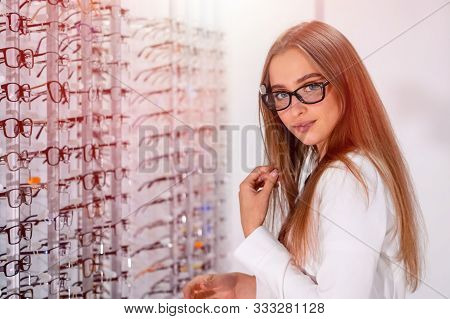 Eyeglasses Commercial. Woman In Spectacles. Choosing Glasses. Client In Optics. Selective Focus. Wom