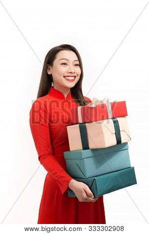 Happy Tet Holiday (chinese New Year). Smile Asian Woman In Ao Dai Holding New Year Gift Box Present.