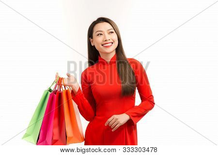 Asian Women Wearing Traditional Aodai Clothes Holding Shopping Bags