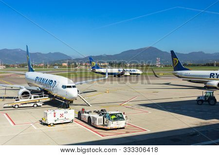 Bergamo, Italy - October 26, 2019: Ryanair planes on the runway of Bergamo Airport in Italy. Ryanair is the biggest low-cost airline company in Europe.