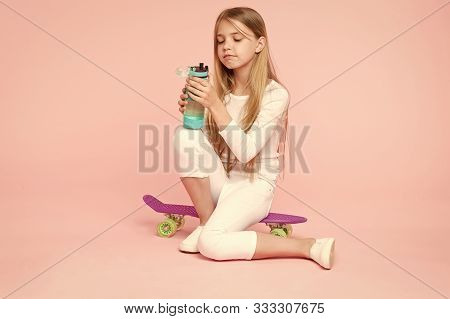 Girl Having Fun With Penny Board Pink Background. Kid Adorable Child Long Hair Adore Ride Penny Boar