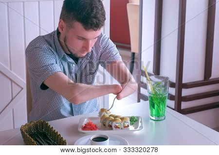 Problem Of Adaptation To Usual Life Guy Without Wrists. Disabled Man With Two Amputated Stump Hands