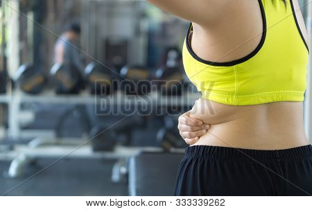 Close Up Woman Holding Excessive Fat Lower Back. Woman Overweight Abdomen. Woman Diet Lifestyle Conc