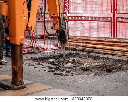 Moscow, Russia - September 14, 2019: An Excavator With Hydraulic Chisel Removes Asphalt Pavement. Ca