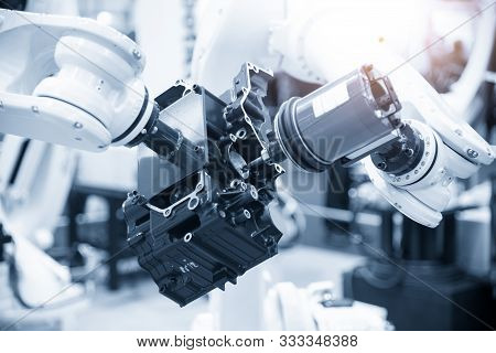 The Automotive Parts Finishing Process By Milling Spindle Attach At The Robotic Arm. The Aluminium C