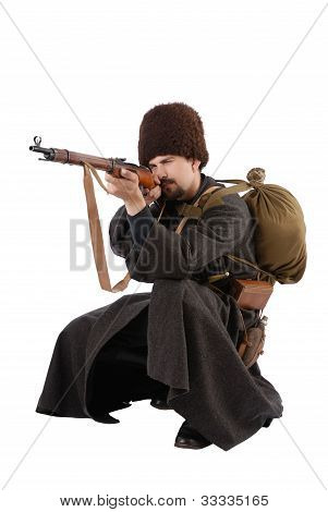 Russian Cossack Points A Rifle In Squatting Position. The Living