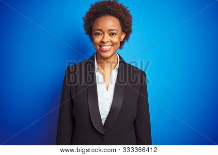 African american business executive woman over isolated blue background with a happy and cool smile on face. Lucky person.
