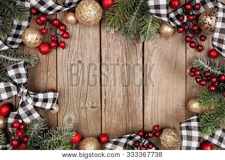 Christmas Frame With White And Black Checked Buffalo Plaid Ribbon, Baubles And Tree Branches. Top Vi