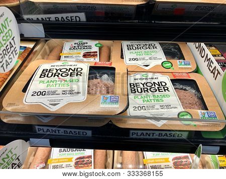 NEW YORK, USA - NOVEMBER 10, 2019: Beyond Meat plant-based burger patties and sausage products on sale inside refrigerator a grocery store in New York, USA.