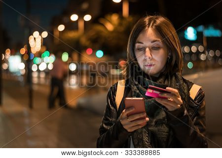 Stock Photo Of A Young Woman While She Is Shopping Online With Her Smartphone. Technology, Lifestyle
