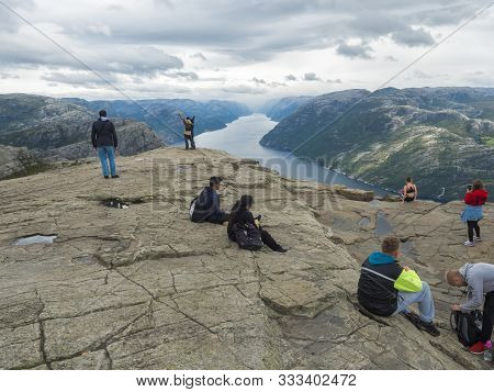 Songesand, Norway, September 9, 2019: Group Of Tourist People Admiring Beautiful View And Posing At