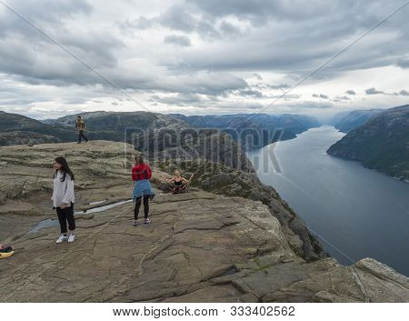 Songesand, Norway, September 9, 2019: Group Of Young Girls Posing For At Photo At Preikestolen Massi