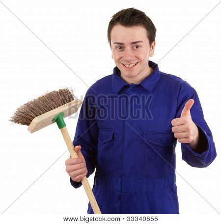 A Worker Holding A Broom