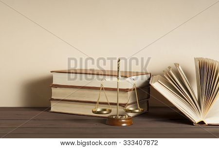 Law Concept. Scales Of Justice And Books On Table In A Courtroom Or Enforcement Office.