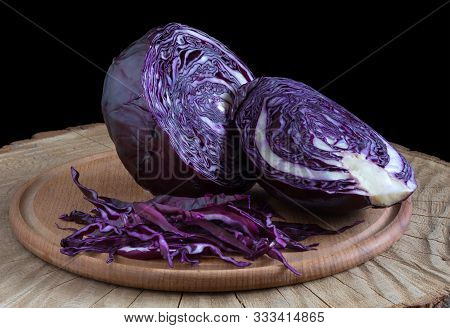 Shredded Cabbage, Red Cabbage On Wooden Cutting Board. Red Cabbage On Black Background.