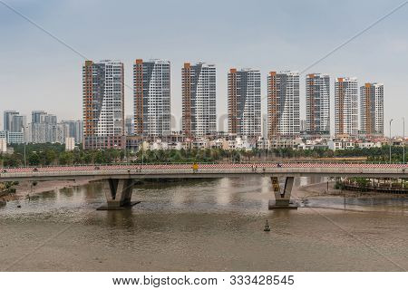 Ho Chi Minh City, Vietnam - March 12, 2019: Song Sai Gon River. Line Of Identical High Rise Apartmen