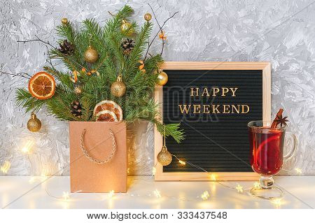 Happy Weekend Text On Black Letter Board, Festive Decored Christmas Tree In Craft Package, Light Lam