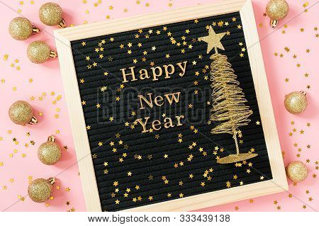 Letter Board With Golden Text Happy New Year And Shiny Christmas Tree On Pink Background Decorated G