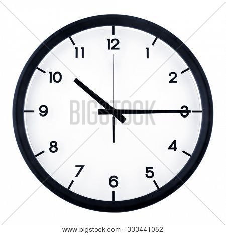 Classic analog clock pointing at ten fifteen o'clock, isolated on white background