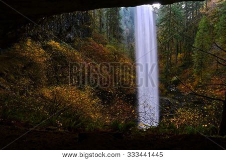 Beautiful Autumn Landscape In Silver Falls State Park Near Salem In Oregon. Behind A Waterfall Hikin