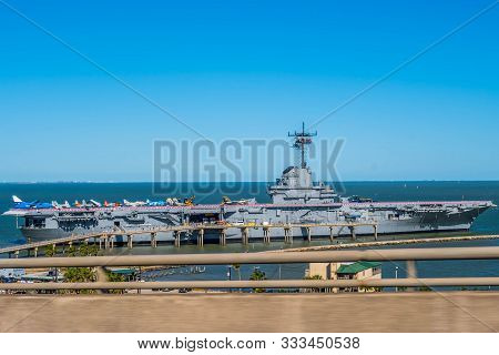 Padre Island Ns, Tx, Usa - April 20, 2019: A Us Warship Aircraft Carrier Along The Shore Of The Isla