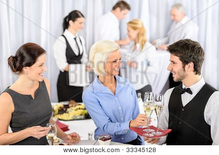 Business woman take aperitif from waiter during company seminar meeting