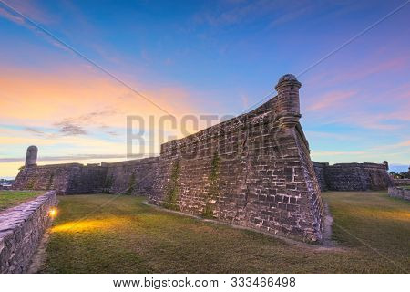 St. Augustine, Florida at the Castillo de San Marcos National Monument at dusk.