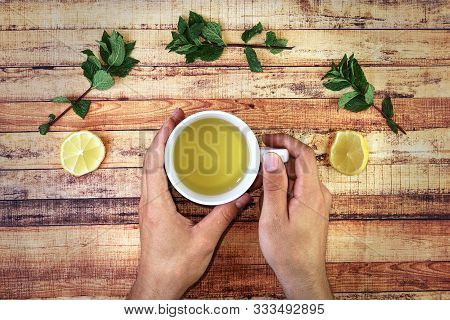 Drinks Hot Salvia Tea For Keep Healthy In Winter Days. Natural And Homemade Herbalism As Mint Leaves