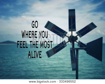 Motivational and inspirational wording - Go Where You Feel The Most Alive. Blurred styled background. poster