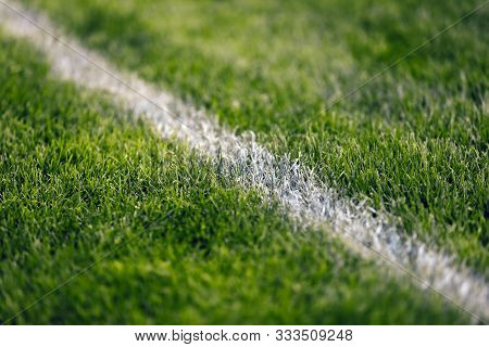 Soccer Pitch White Line. Grass Football Field. Close Up Of Sports Grass Venue