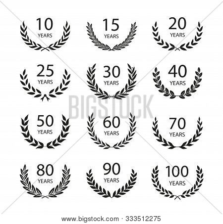 Set Of Anniversary Laurel Wreaths. Black And White Anniversary Symbols Isolated On Black Background.