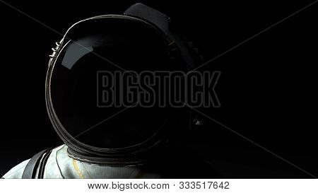Astronaut In A Metal Helmet Close-up In The Light And Dark. Computer Generated Space Background, 3d