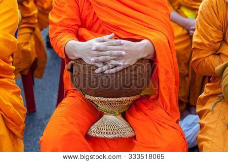 Buddhist Monk's Bowl In Hands. Thai Monk Bowl For Alms Collection. Version 2.
