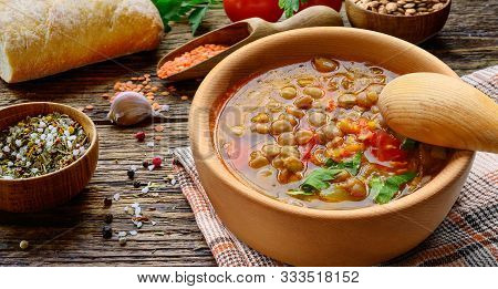Lentil Soup In Wooden Bowl With Vegetables And Home-baked Bread On The Rustic Wooden Table.