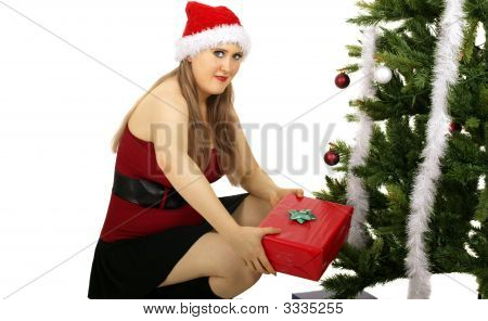 mrs santa claus bring a gift to put under christmas tree poster