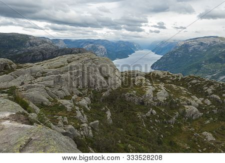View On Fjord Lysefjord, Next To Preikestolen Massive Cliff Famous Norway Viewpoint Moody Sky, Autum