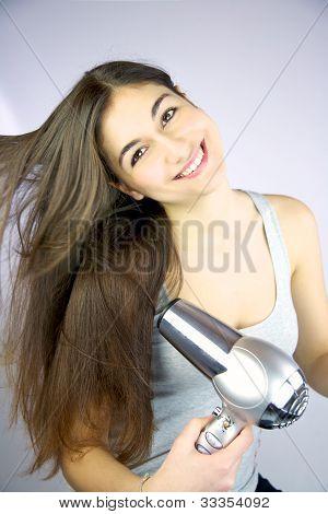 Happy Girl Drying Her Long Hair