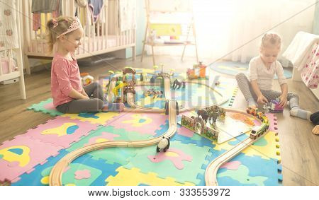 Girls Play With A Wooden Set