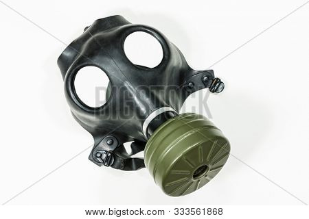 Old army surplus gas mask with white background.