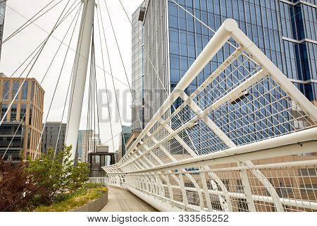 Closeup Of Millennium Bridge Structure At The Riverfront Park Neighborhood Of Denver. Commons Park