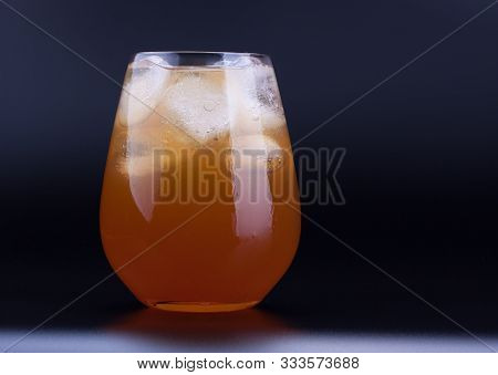 Big Glass Of Ice Tea With Ice Cubes, Black Background