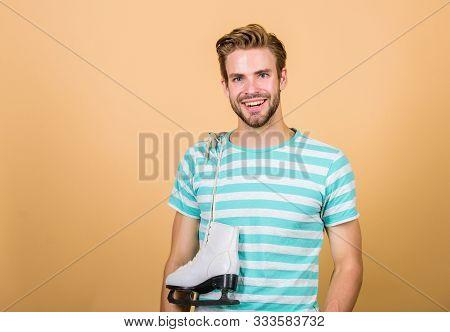 Figure Skating Sport. Man Handsome Athlete With White Skates Sport Equipment. Sportsman Coach Athlet