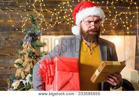Man Bearded Hipster Wear Santa Hat Hold Bunch Of Letters And Gift Box. Letter For Santa Claus. Man B