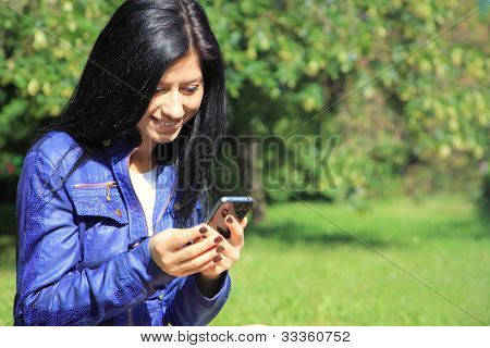 Young Woman Looking At Phone .